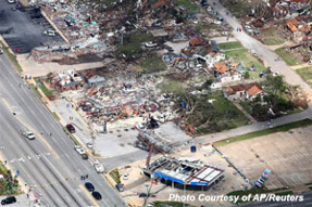An aerial view shows extensive damage to homes and businesses in the path of tornadoes in Tuscaloosa, Alabama